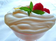 After a nice dinner in an Italian restaurant, my mom,  daughter And I shared a fabulous dessert - the sweet cream was rich and berries were layered inside.  I went on a mission to re-create the dessert and came up with this recipe.  The cream is soft - not stiff or firm, like whipped cream.  You can use your favorite fresh fruit or coulis.  Layer it in a clear glass goblet or parfait dish; about 2 cups of berries or fruit coulis will be right.