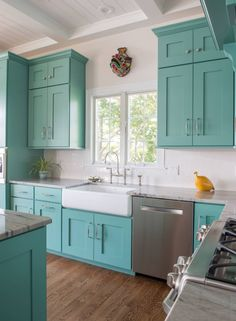 "Turquoise kitchen cabinets with white farmhouse sink // Sherwin-Williams ""Composed"" SW 6472"