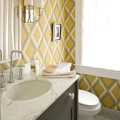 Peek a boo hex subway tile, brown, yellow  and gray - YUCK on the wallpaper, but a good look at color combination for bathroom