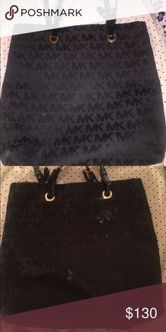 A Black Micheal Kors tote It's all black but it has 3 paint stains but can be easily removed/cleaned. Michael Kors Bags Totes