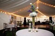Hydrangea centerpiece in tent. Wedding flowers.