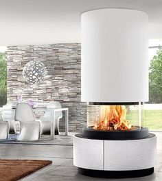 OSLO - a panoramic in the centre of the room. A nice solution to divide open spaces but also to see the flame from different points of view. Fireplace Design, Fireplace Mantels, Oslo, Living Room With Fireplace, Open Plan Living, Glass House, Home Look, Luxury Living, Cladding