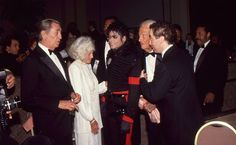 MJ and legendary actor Robert Mitchum at the 7th American Cinema Awards at the Beverly Hilton Hotel, Beverly Hills January 27 1990