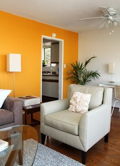 Paint colors that match this Apartment Therapy photo: SW 2838 Polished Mahogany, SW 7745 Muddled Basil, SW 6097 Sturdy Brown, SW 6890 Osage Orange, SW 7644 Gateway Gray Living Room Decor Orange, Accent Walls In Living Room, Accent Wall Bedroom, Living Room Colors, Orange Accent Walls, Yellow Walls, Home Bedroom, Home Living Room, Room Wall Colors
