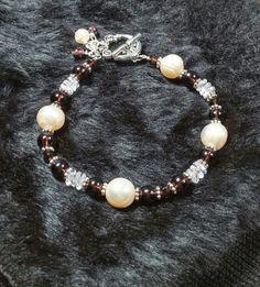 Cultured pearls and dark purple glass beads and Swarovski crystals. Beansandbellas on fb