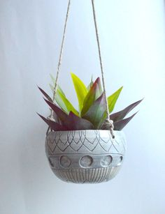Need some green in your life? Try this sweet little hanging planter in your windowsill. Planter measures 6 inches at the widest point, and about 5 inches