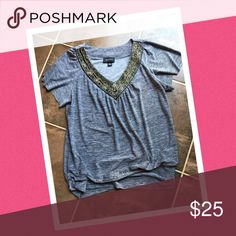 AB Studio dress shirtNEW LISTING Gorgeous black/gray short sleeve with beautiful beaded embellishment around the v-neck collar. No signs of wear. Barely worn. Loose fitting with a thick elastic waist band. AB Studio Tops Tees - Short Sleeve