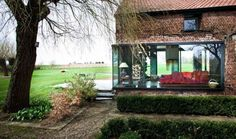 Contemporary glass addition to the old farmhouse