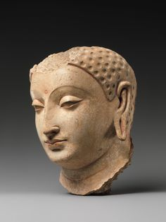 Head of Buddha, 5th–6th century, Afghanistan (probably Hadda), Stucco with traces of paint, H. 7 1/4 in. (18.4 cm) | The Metropolitan Museum of Art