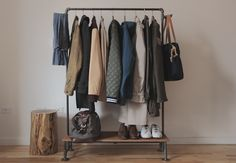 """DIY Industrial Clothing Rack - 1/2"""" black steel pipes and fitting, oak wood shelf at the base"""