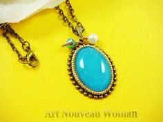 Blue Cabachon Pendant circled by tiny gold seed beads in gold bezel, 18 inch antique bronze chain.. $9.00, via Etsy. NEED IT.