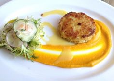 Artisan Restaurant in the Delamar Hotel, Southport, CT:We began with a mostly-crab cake (as it should be) in a swirl of delicate carrot-ginger puree, garnished with a lightly dressed salad ($15). The photo shows only half a portion, as we shared!