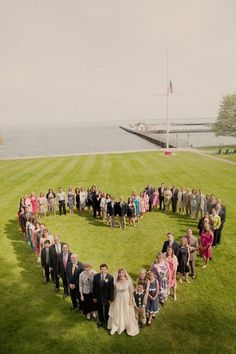 Such a unique take on a wedding party photo - do in the shape of the first letter of new last name.
