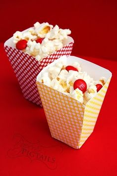 Such a cute snack idea for a party.  Popcorn and red M's really go with the fire truck theme!