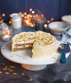 Swedish almond cake, also known as mandeltårta, is a light, fluffy cake with a creamy custard icing and toasted almonds.