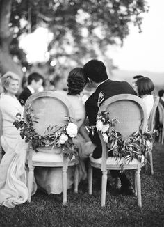 Olive branch swag for the sweetheart chairs | Photo by Jose Villa