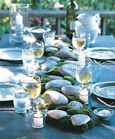 Whether the materials come from your backyard or a garden center, its easy to incorporate natural elements into the centerpiece of an alfresco dinner. Position stones down the middle of an outdoor table, and intersperse bunches of cushion moss. Moss Centerpieces, Summer Centerpieces, Wedding Centerpieces, Centerpiece Ideas, Outdoor Table Centerpieces, Outdoor Decorations, Outdoor Ideas, Creation Deco, Easy Entertaining