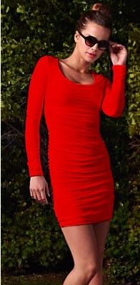 Sydney Dress in Red at Pesca Boutique. This sexy, curve-hugging mini dress features a deep scoop neckline. Offers long sleeves and an exposed back zipper. Also comes with ruching/sheer ruched mesh overlay all throughout. Hem hits mid-thigh. Available in solid red. - Price: $209.00