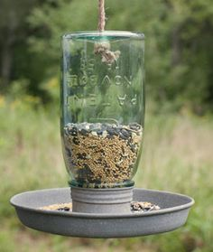 Birds of a feather flock together. Hang this cute Mason Jar Bird Feeder to keep you fine feathered friends happy and coming back for more. The mason jar unscrews from the base for easy filling. A rope