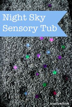 Nigth sky sensory tub for sensory play, space theme and with ideas for hands-on math games.