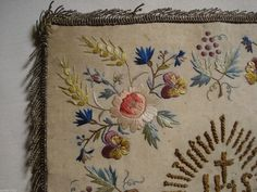 http://www.ebay.com/itm/antique-1800-silk-embroidered-Chalice-cover-pansies-roses-/401115259226?hash=item5d6455215a:g:oJoAAOSwYmZXKJsG