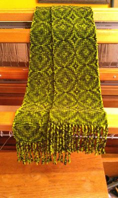 """Handwoven Chenille Scarf. Handwoven 80""""x8"""" cotton chenille scarf in """"Shadow Weave"""" pattern black and chartreuse. Artist: Judy Donovan. Donated by the artist."""