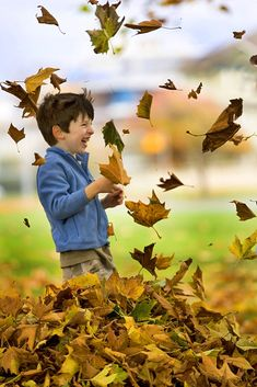 Finding joy in blowing Autumn leaves  -------     (Photo by Darren Stone)
