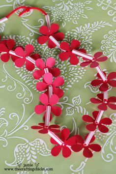 Hawaiian Leis Craft For A Luau Party - DIY using card stock, flower punch and cut drinking straws.