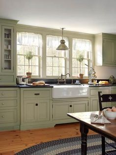 New double-hung windows and an apron sink echo the 19th century period look of this kitchen redo. | Photo: Tria Giovan | thisoldhouse.com