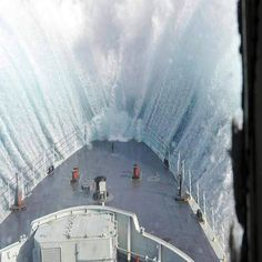 Giant wave crashing into a ship