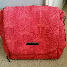 """Petunia pickle bottom diaper bag Petunia pickle bottom """"notting hill"""" Diaper bag. Coral bright pink color Magnetic and snap closure. Comes with backpack straps, long shoulder strap, changing pad and wipes case. Bought off posh, I've never used it previous owner did. Hubby has bought me 2 other bags so this one isn't needed. Rare bag. Small ink stain shown in pic 4 on inside of flap, hardly noticeable. I posted addt'l pics up on my page. Last buyer changed her mind and seemed shady. Feel free…"""