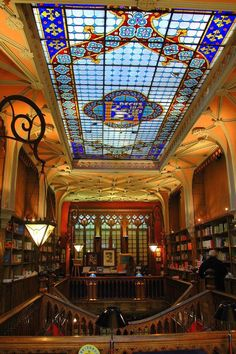 Discover Livraria Lello in Porto, Portugal: One of the most beautiful bookstores in the world hides a neo-Gothic interior behind an art nouveau facade. Art Nouveau Interior, Gothic Interior, Interior Design, Livraria Lello Porto, Beautiful Library, Famous Castles, Book Nooks, Beautiful Buildings, Stained Glass Windows
