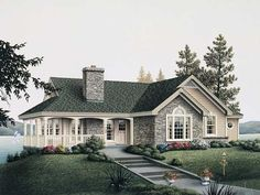 This Cottage home plan with Country style influences has 1922 sq. ft. of space. The 1 story plan has a wraparound porch, and a mix of stone and vinyl siding. #country #houseplan