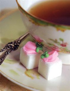 DAINTY ROSEBUD SUGAR CUBES (BOX OF 20). You can make these easily with a floral piping tip.