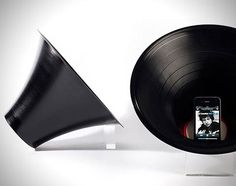 an iphone amp built for a vinyl record. simple. i wonder if it smells though...