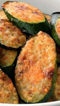 Parmesan zucchini bites ~ Just 5 ingredients and only 15 minutes of prep... One of the simplest dishes to make, They're tasty and good for you, too. Breaded Zucchini Parmesan Is Fried Until Crispy And Baked In A Casserole Dish With Layers Of Marinara Sauce And Mozzarella Cheese. Veggie Dishes, Food Dishes, Zucchini Side Dishes, Parmesan Zucchini Bites, Garlic Parmesan, Parmesan Cauliflower, Roasted Garlic, Zucchini Fries, Zucchini Noodles