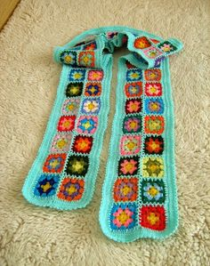Granny square scarf by turtlemurtle on etsy- I want to make one of these for ME. Once people I love will stop having babies...lol