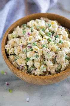 This Tuna Pasta Salad with shell noodles, peas, tuna, celery, and Greek yogurt is fast, healthy, and a dish your whole family can enjoy!