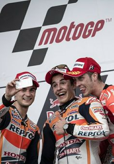 Marc Márquez (centre) in a podium selfie having won the MotoGP of the Americas with second-placed team-mate Dani Pedrosa with Andrea Dovizioso
