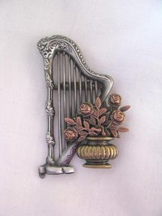 Lovely harp pin brooch with flower urn. VIntage mixed metals brooch by TheBroochMaven, $8.99 USD