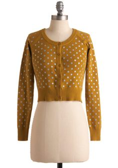 this + very snug black pencil skirt + black tights + black very high heel booties = Yes, that's totally how I'll wear it!        this + faded black skinny jeans + chucks = How I'll actually wear it.
