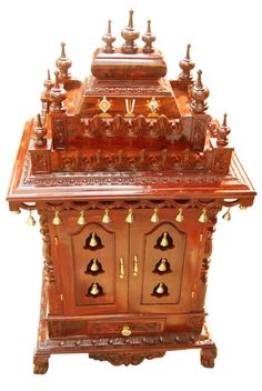 Latest Pooja mandir for home with wooden, gopuram, and pooja bells. If you are looking for home pooja mandir. Please contact us immediately. Temple Design For Home, Home Temple, House Warming Ceremony, Mandir Design, Pooja Mandir, Pooja Room Door Design, Seasoned Wood, Puja Room, Indian Homes