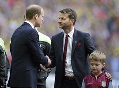 Prince William (left) shakes hands with Villa boss Sherwood ahead of the 5.30pm kick-off a...