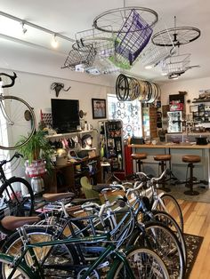 Wheels holding baskets from the ceiling at The Dropout bike shop in Reno
