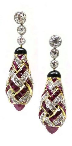 A pair of Edwardian ruby and diamond earrings, circa 1910. Bombe drops formed by a lattice of rubies and diamonds, suspended from a line of three diamonds. #antique #earrings