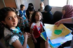 Refugee children in a classroom >>> The Georgia Budget & Policy Institute blog describes exactly how refugees bolster and enrich life in the region — empirical evidence refuting widespread paranoia, fanned by unscrupulous politicians trying to gain from inciting fear.