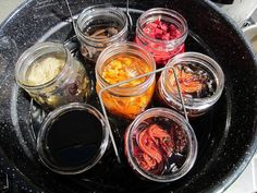 Dying in Mason Jars - A pot full of various mushroom dyes.