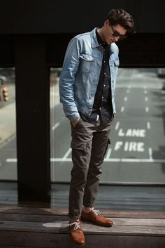 Opt for a black longsleeve shirt and charcoal cargo pants for a trendy and easy going look. Dress it up with brown leather derby shoes. Shop this look for $183: http://lookastic.com/men/looks/black-longsleeve-shirt-and-light-blue-denim-jacket-and-charcoal-cargo-pants-and-brown-derby-shoes/3854 — Black Longsleeve Shirt — Light Blue Denim Jacket — Charcoal Cargo Pants — Brown Leather Derby Shoes