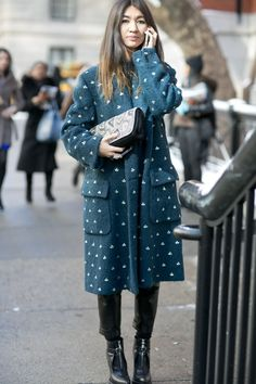 Pin for Later: Flashback Friday: NYFW Street Style Stars Trekked Through the Snow For Fashion NYFW Street Style Day 5 Details, like a special print on your outerwear, can change the whole feel of an outfit.  Source: Tim Regas