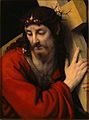 A close up picture of Jesus with the cross climbing up to the Crucifixion.